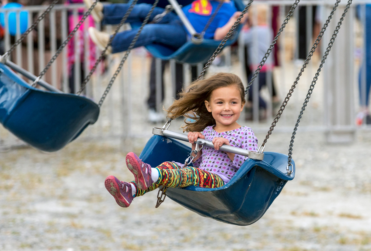 Fuquay-Varina 3-year-old Sage Bourque rides the swings at the Celebrate Fuquay-Varina Festival 2019.
