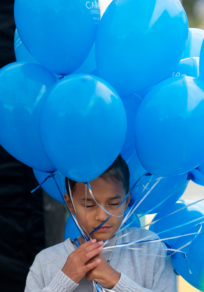 Melina Martinez, 8, gets tangled in bunch of balloons at the Carolina Orthodontics Children's Dentistry booth at the Celebrate Fuquay-Varina Festival 2019.