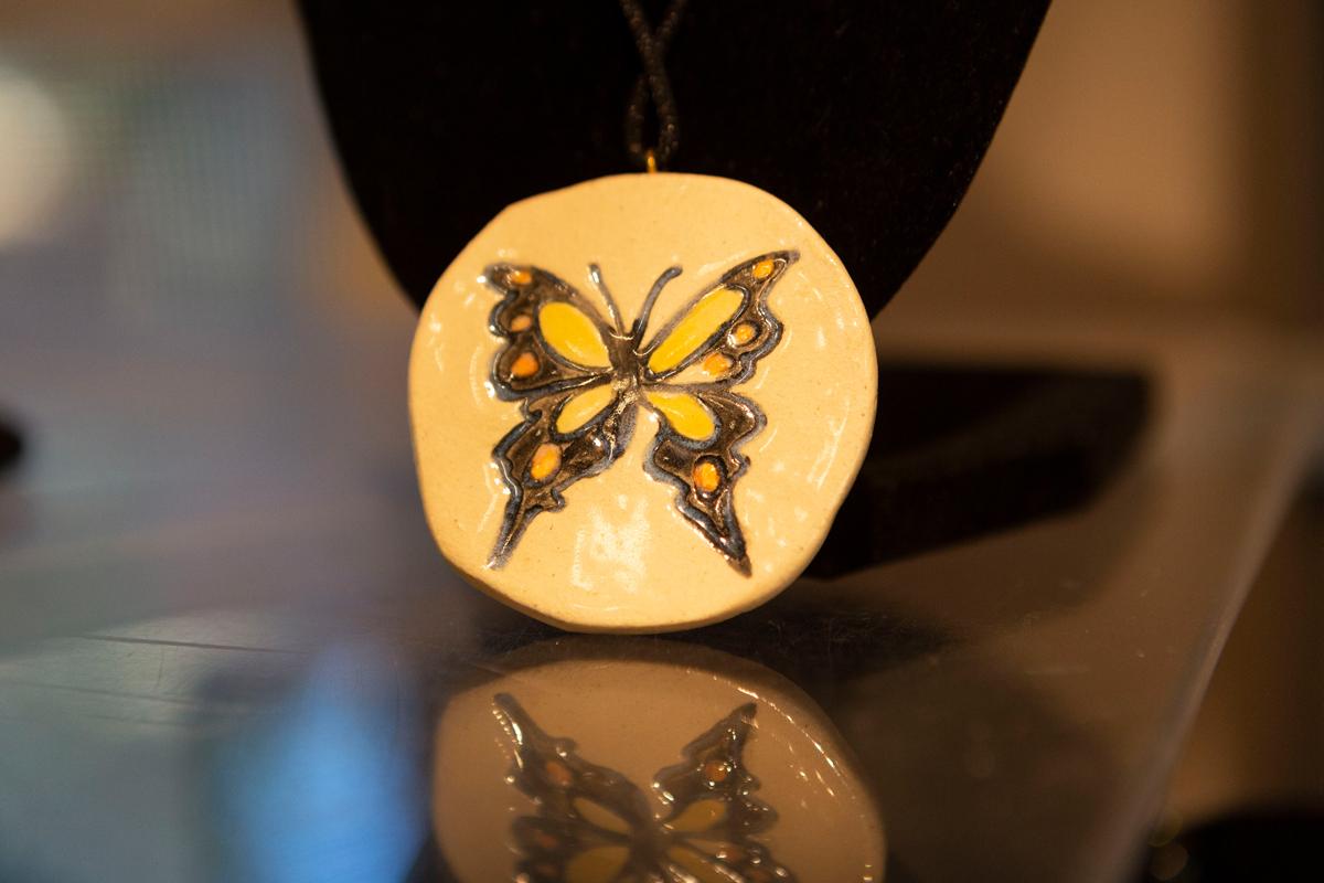 Piedmont Pottery co-owner Lisa Ross' ceramic medallion.