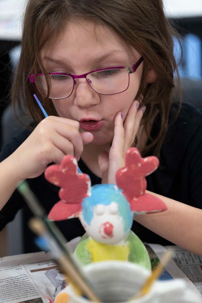 Harper Fisher, 7, paints her bisque porcelain