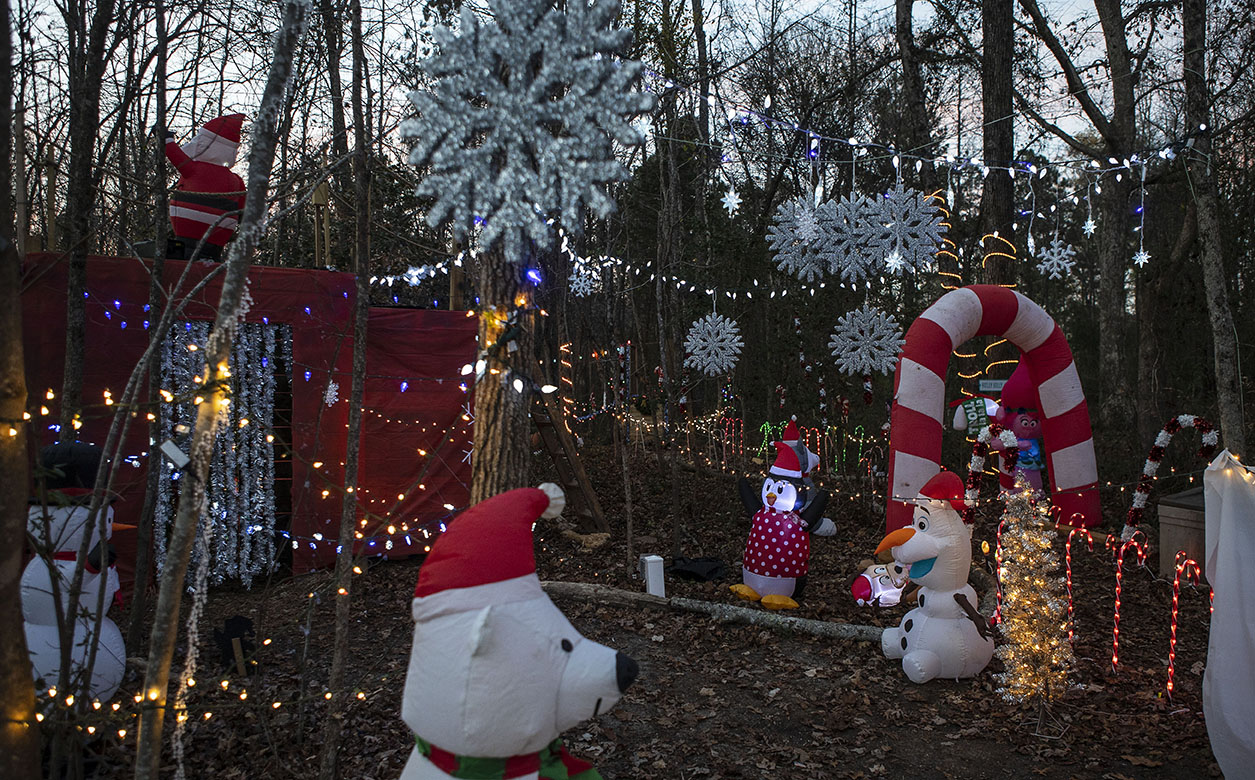 Seventh-grader Josh Sutton, of Willow Spring, constructs a walk-through holiday light trail at his home. Sutton guides neighbors and friends through the trail on select weekend nights each year, as he has done since the second grade.