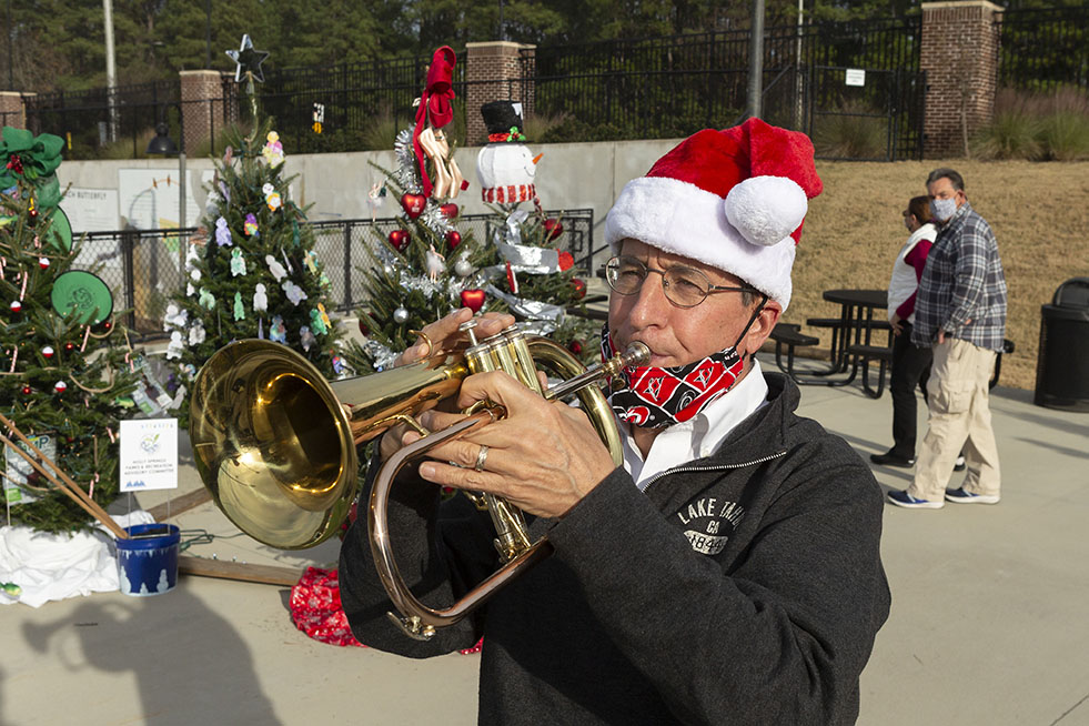 Robbie Spiers performs at the Happy Holly Days Tree Trail at Ting Stadium